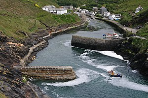 Breakwater and fishing boat near the harbour o...