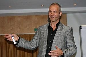 Matthias Poehm on stage holding the seminar 'P...