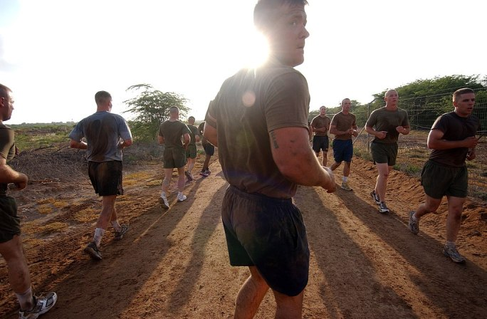 US Navy 060327-N-0411D-013 Navy Equipment Operator 3rd Class John Palmer leads early morning physical training at the Marines Corporal's Course aboard Camp Lemonier, Djibouti