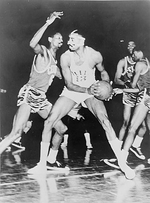 Wilt Chamberlain and Bill Russell during a bas...