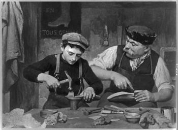 English: Apprentice. Man and boy making shoes.