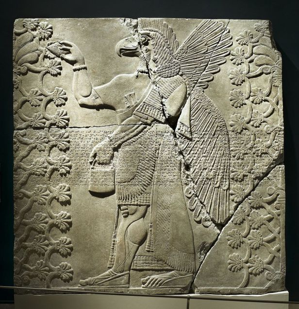 Assyrian. Relief of Eagle-Headed Winged Figure Standing Between Two Sacred Trees