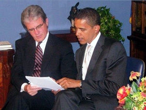 """Dr. Coburn and Senator Obama look over t..."