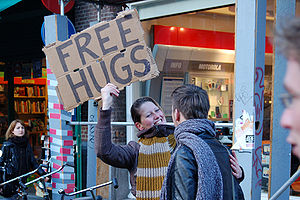 English: 'FREE HUGS', with a smile. Amsterdam....