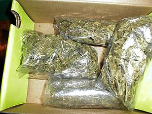 English: Four ounces of low-grade marijuana, u...