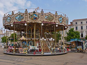 a french old fashioned merry-go-round, with st...
