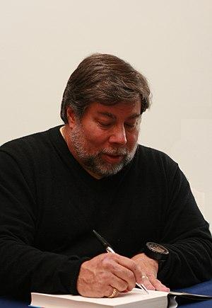 Steve Wozniak signing books.