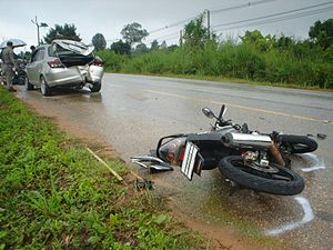 A motorcycle crashed a Honda City sedan car