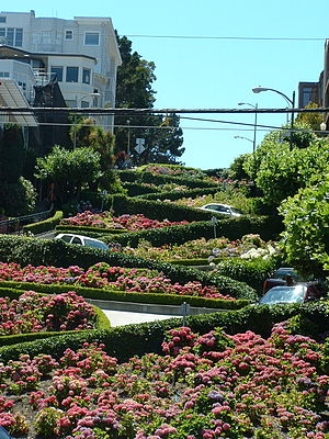 Cars negotiate Lombard Street's famed twisty s...