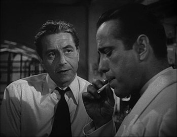 This screenshot shows Paul Henreid and Humphre...