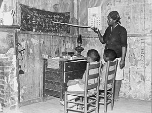 """Negro mother teaching children numbers a..."