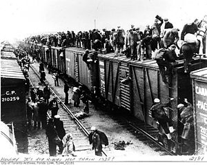 Unemployed men hop train. Canada.