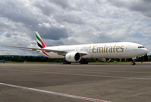 Emirates Airline Boeing 777 at an airport.