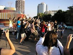Happy People Dancing On Planet Earth