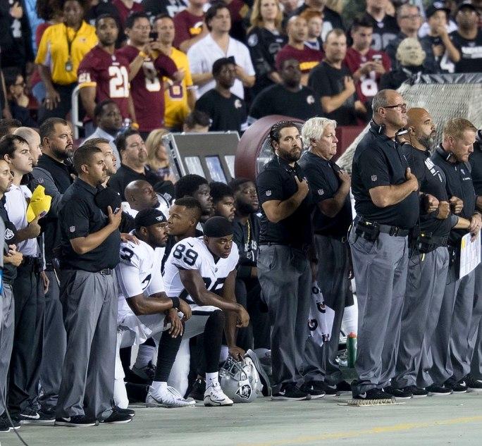 Oakland Raiders National Anthem Kneeling (37444579735)