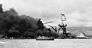 The burning wreckage of the U.S. Navy battlesh...