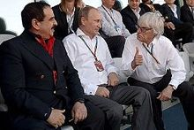 King Hamad with Russian President Vladimir Putin and British business magnate Bernie Ecclestone, Russian Grand Prix. 12 October 2014