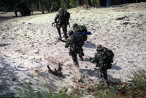 Philippine Marines charge up the beach at Mari...