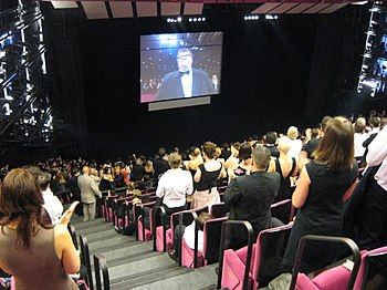 Michael Moore at the 2007 Cannes Film Festival receiving a standing ovation for Sicko