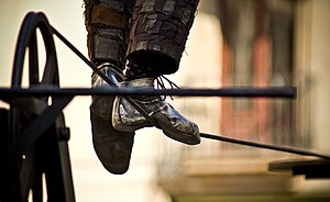 The feet of a tightrope walker.