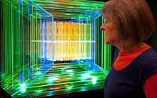 Dorothy Tanner looking at the light sculpture, Logo, by Dorothy and Mel Tanner.jpg