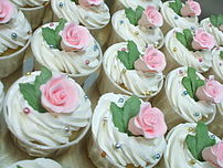 Cupcakes topped with frosting and gumpaste flowers