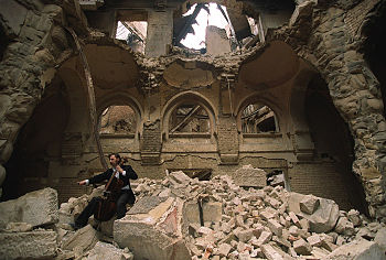 A cello player in the partially destroyed Nati...