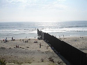 US Mexico border fence extends into the Pacific Ocean