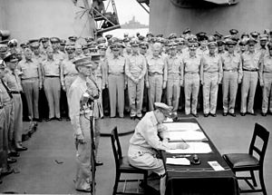 Douglas MacArthur signs the formal surrender o...