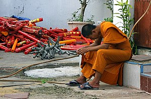 Buddhist monk in Bangkok Thailand wearing saff...