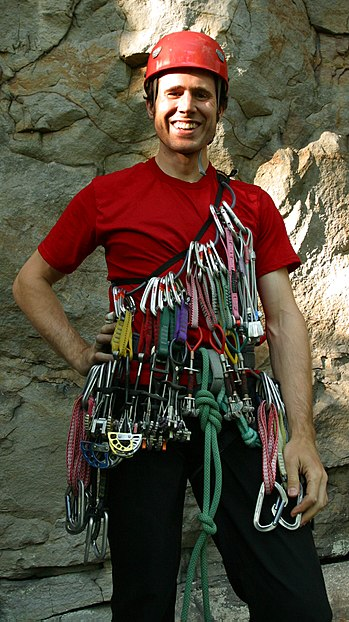Rock climber with rope, harness, helmet, SLCDs...