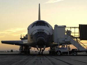Discovery safe back at landing strip. Cropped ...