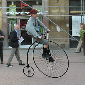 An ordinary bicycle. Man riding the bicycle in...