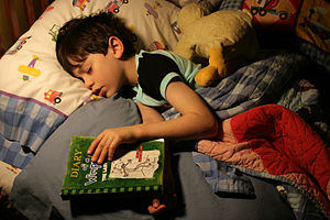 "English: Six year old boy reading ""Diary ..."