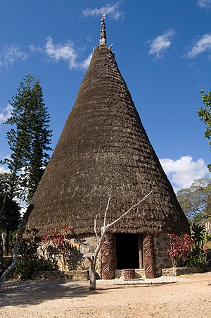 Kanak house with flèche faîtière. Tjibaou cult...