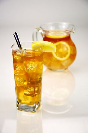 Pitcher of Iced Tea with a Glass of Ice Tea.