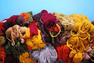 Skeins of wool yarn hand spun and naturally dy...