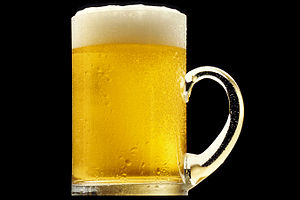 A mug of golden beer with a white froth; again...
