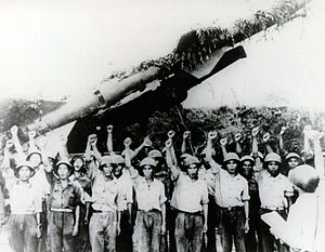 English: North Vietnamese SAM crew in front of...