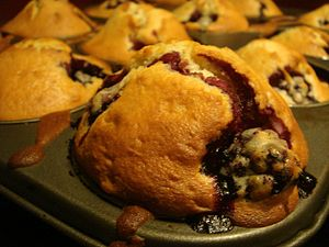 Blackberry muffins in a baking pan.