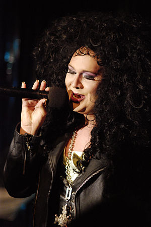 English: A drag queen impersonating Cher for a...