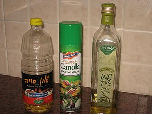From left to right: bottle of soy oil, canola ...