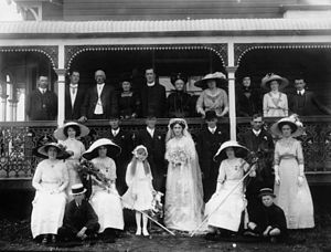 English: Fashionable wedding group, ca. 1911 B...