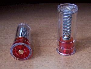 A pair of 12 Gauge snap caps.