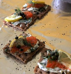 Gravlax on crisp bread, garnished with pepper ...
