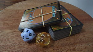 English: Cards and dice (used to mark life poi...