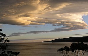 English: A lenticular cloud being overlooked f...