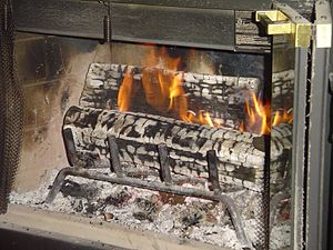 Wood burning in a fireplace.