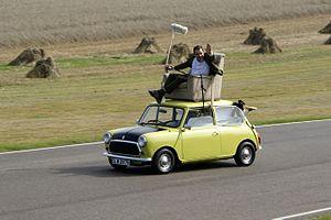 Rowan Atkinson on a Mini at Goodwood Circuit i...