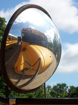 The front crossview mirror of a school bus; it...